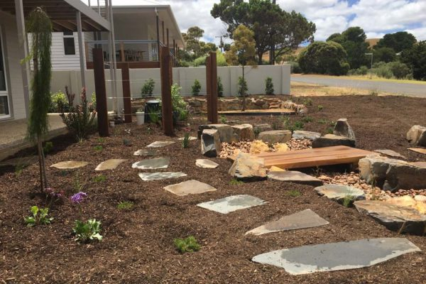 Dry creek bed with pavers along side - Adelaide Landscaping - TGLandscapes